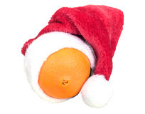 Christmas cap on orange Royalty Free Stock Photos