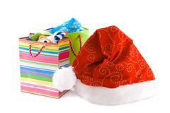 Christmas cap and  packages with gift Royalty Free Stock Image