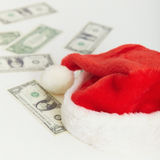 Christmas cap and the scattered money Stock Image