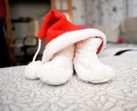 Christmas cap and valenoks Royalty Free Stock Photos