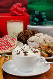 Christmas cappucino and cookies. A cup of cappuccino or hot chocolate with Christmas cookies royalty free stock photo
