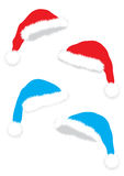 Christmas caps. Isolated christmas red and blue caps on the white background royalty free illustration