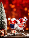 Christmas caps in shopping cart Royalty Free Stock Image