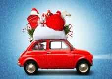 Christmas car. Santa Claus with gift bag royalty free stock images