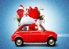 Christmas car. Santa Claus with gift bag stock photography