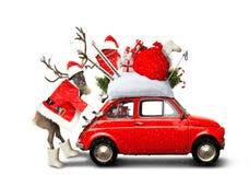 Christmas car. Santa Claus with gift bag stock image