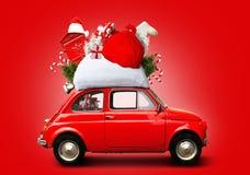 Christmas car. Santa Claus with gift bag stock photography