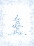 Christmas Card. Light-Blue Christmas Tree On Snow-Covered Background Royalty Free Stock Photography