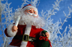 Christmas card. Santa Klaus, sky, frost, bag royalty free stock image