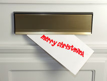 Christmas Card. A christmas card arrives in the mail Royalty Free Stock Photography