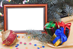 Christmas Card. With gift boxes and Christmas ornaments Stock Photos