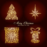 Christmas card. With fir tree, star, gift box and bell made from gold snowflakes, Christmas decorations and a wish of Merry Christmas and a Happy New Year on Royalty Free Stock Photos