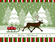 Christmas card. With reindeer pulling sledge with gifts Royalty Free Stock Photo
