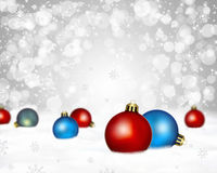 Christmas card. Snowy background with christmas ornaments Royalty Free Stock Photography