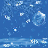 Christmas card. Glass ball and snowflakes on a  blue background Royalty Free Stock Photography