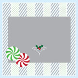 Christmas Card. A Christmas card border with peppermints and holly Royalty Free Stock Images