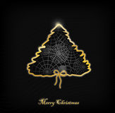 Christmas card. Christmas tree made of a gold ribbon with a pattern inside on a black background Stock Photo