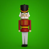 Christmas Card. Christmas Nutcracker soldier on green. Isolated - clipping path included for easy selection Royalty Free Stock Photo
