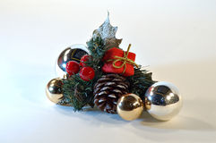 Christmas card. Christmas ornament, christmas card with a smal gift, golden and silver balls Royalty Free Stock Images