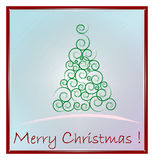 Christmas card. Green Christmas Tree isolated on a blue background Stock Photos