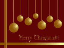 Christmas card. Golden balls on red with ribbon Royalty Free Stock Photo