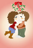 Christmas card. About man and woman kissing under the mistletoe Stock Image