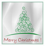 Christmas card. Green Christmas Tree isolated on a silver background Royalty Free Stock Photography