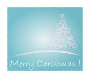 Christmas card. White Christmas Tree isolated on a blue background Stock Photos