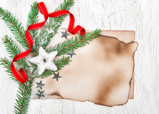 Christmas card with aged paper, stars and fir branches Royalty Free Stock Photos
