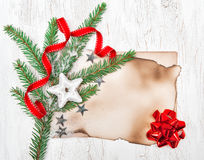 Christmas card with aged paper, stars and fir branches Stock Photo