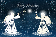 Christmas card with Angel and stars on the night sky. Stock Images