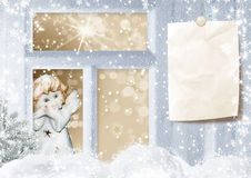 Christmas card with angel in the window Stock Photography