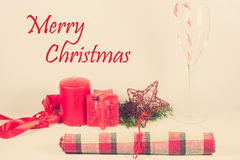 Christmas card arrangement with red candle Stock Images
