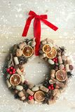 Christmas in a rustic style. Handmade decor. Christmas wreath on the background of old boards. Festive mood. Christmas card. Background Christmas and new year stock photo