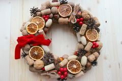 Christmas in a rustic style. Handmade decor. Christmas wreath on the background of old boards. Festive mood. Christmas card. Background Christmas and new year stock images