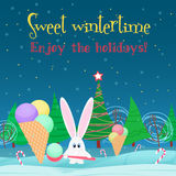 Christmas card background. Rabbit with ice cream candy in the christmas tree night forest. Stock Photography
