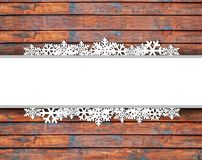 Christmas card background with snowflakes and wooden texture Stock Photo