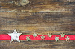 Christmas card background with stars on red ribbon border. Royalty Free Stock Photography