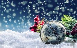 Christmas card with ball fir and decor on glitter background. Christmas ball on glitter background. Xmas Royalty Free Stock Photo