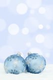 Christmas card balls baubles blue background snow decoration Stock Photography