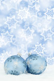Christmas card balls baubles blue background winter snow decorat Royalty Free Stock Photography
