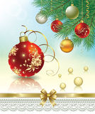 Christmas card with balls. On the branches of a Christmas tree Royalty Free Stock Photos