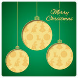 Christmas card with balls cut from paper. Classic green top layer and gold seamless pattern below. Design of bells, tree, balls an stock photos