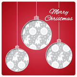 Christmas card with balls cut from paper. Classic red top layer and silver seamless pattern below. Design of the bells, balls and Royalty Free Stock Photography