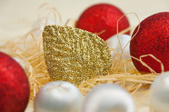 Christmas card with balls and gold leaf Stock Photos