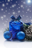 Christmas card with balls. And ornaments on a blue background Royalty Free Stock Photos