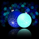 Christmas card with balls and reflection. Blue Stock Photos