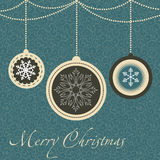 Christmas card with balls and snowflakes. Royalty Free Stock Image