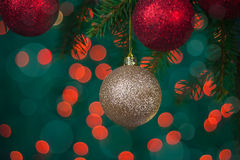 Christmas card with balls and spruce twig royalty free stock photos