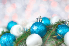 Christmas card with balls, spruce twig and bokeh stock photos